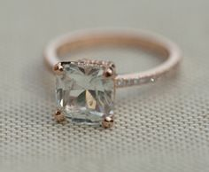White sapphire engagement ring. Asscher cut ring. Engagement ring by Eidelprecious. Very beautiful ring features a natural non-treated sapphire in gorgeous Ice color. This stone is 3.41ct, asscher cut, unheated. The color is white with faint ice blue overtone at certain lightening. It is set in m
