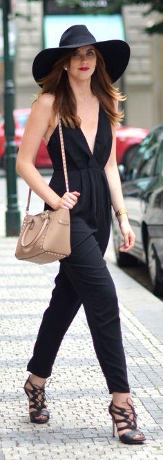 Back Floppy Hat Black Plunging V-neck Jumpsuit Black Cutout Heels by Vogue Haus