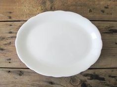 Love, love, love creamy white serving platters and the simple scalloped edge is so lovely.