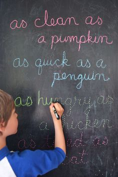 kids can practice cursive writing by tracing words on a chalkboard (simile's by 7yr old!)