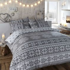 Duvet cover in grey. Winter bedding in a warm flannelette quilt cover set with Nordic snowflake designs in white. Insbruck duvet cover set.