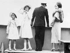 Candid: This never-before-seen photograph shows the Queen, second left, as a teenager with her sister Margaret and her parents George VI and...