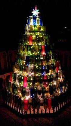 Wine bottle Christmas tree made by Stewart Welding for back deck