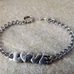 Love Cross Metal Charm Bracelet by WireNWhimsy on Etsy, $38.00