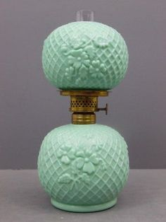 "Circa to early "" Marguerite"" green milk glass miniature kerosene lamp made by the Fostoria Glass Co. Please reference Melvin Murray's book ""Fostoria, Ohio Glass II"". Lamp is 3 tal. Antique Oil Lamps, Décor Antique, Antique Lighting, Vintage Lamps, Vintage Glassware, Antique Dishes, Green Milk Glass, Milk Glass Lamp, Glass Lamps"