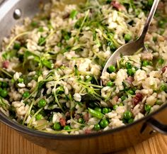 This traditional Italian dish of rice with peas is best made in the spring when fresh peas in the pod are at their sweetest It is similar to risotto, but a bit on the soupy side, and less rich A flavorful homemade chicken broth is essential