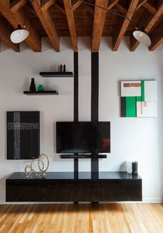 Custom artworks and stripes, Serge Mouille ceiling Lamp, styled with CB2 and IKEA accessories.