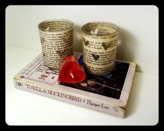 Book Page Candle Holders Wrap candle holders with book pages on the outside and cut little shapes to let the candle light or LED tea lights shine through. Source: Etsy user AdorkableMe