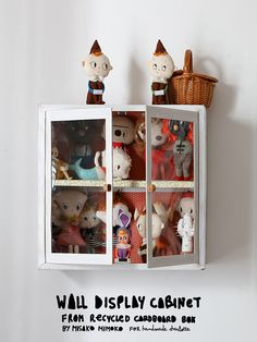 Turn a cardboard box into a DIY display cabinet for your toys and dolls!