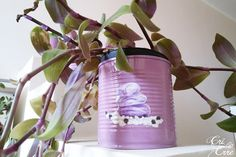Make easy personalized DIY flower pots from tin cans! Fill your home up with plants in colorful eco-friendly pots with your favorite decoupaged images!