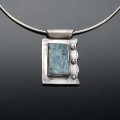 'Water of the Sea' Aquamarine and Sterling Silver Pendant Aquamarine is a powerful stone for cleansing the emotional and for opening communication. It is said that it helps one to realize and understand emotional patterns with its gentle energy. Metal Clay Jewelry, Glass Jewelry, Stone Jewelry, Pendant Jewelry, Gold Jewellery, Jewellery Shops, Garnet Jewelry, Diamond Jewelry, Sterling Silver Necklaces