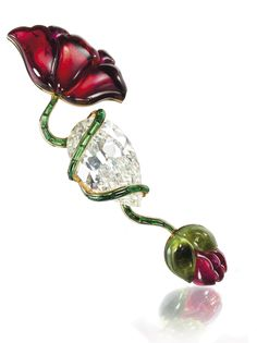 Joel Arthur Rosenthal - pear-shaped diamond and tourmaline brooch in which the poppy stem coils around the 37.23 carat diamond (estimate $500,000 to $700,000). One of Lily Safra's collection.