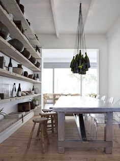 love the ghost chairs with the rustic stools and the metal table....shelves, too    B L O O D A N D C H A M P A G N E . C O M: