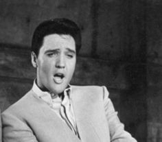 Elvis Presley he could sing to me anytime ..... Well I guess just through music videos now !!!!   :  )
