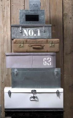 Various vintage suitcases and boxes stacked. Loods5
