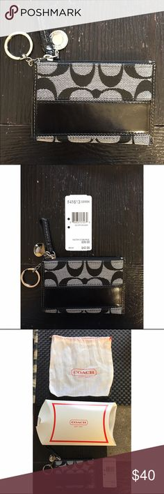 NWT Coach Wristlet Brand new with tags black & white Coach Wristlet with silver hardware. Received as gift but no longer wanted. Comes with cloth storage bag and Coach tags. Price is final! Coach Bags Clutches & Wristlets