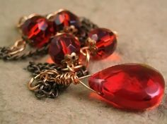 Red glass necklace with copper chain and filigree beadcaps by TheAmethystDragonfly on Zibbet.