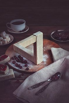 """From the article: """"Russian self-taught photographer Dina Belenko creates alluring still life images which she calls """"photoillustrations"""". Combining creative and well arranged compositions with photography and a little bit of photo manipulation skills, Belenko creates beautiful food photography starring various inanimate objects: food products, utensils and other props."""""""