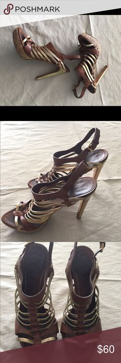 Authentic Miu Miu high fashion sandal heels!! Authentic and fun and gorgeous! Gold  and light brown strapped sandal heels size: eu: 39.5 or us: 9.5. Preloved by a narrow foot so leather is not too stretched, with scuffs - cork platform - surprisingly comfortable for a high heel!! Make an offer!! Miu Miu Shoes Heels