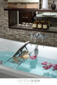 Bathroom Design Ideas • Mosaic Tile Wall • Wall-Mounted Faucet for the Bathtub • Built-In Shelving for the Bathtub • Shelving with Mirror-Backs • Relaxing Spa Bath Ideas • #candiceolson #candiceolsondesign Mosaic Tiles, Wall Tiles, Candice Olson, Soaker Tub, Bath Ideas, Creative Design, Faucet, Shelving, Bathrooms