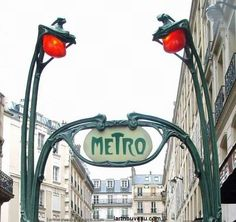 You see a photo of the *real* metro station sign in Paris, and it reminds you of the replica on Michigan Avenue.
