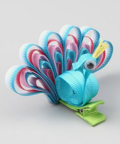 peacock hair clip!! So cute!! @Renea Hamalainen Monanteras, think you could make this with your genius bow making skills?