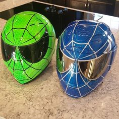 Custom painted Spider-Man helmets.  The  green one is on the Z1R Strike Ops and the blue is on the Icon Airmada. Custom painted by airgraffix.com  #airgraffix #customhelmets #venom #spidermanhelmet #venomhelmet #spidey #spiderman