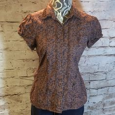 MAURICES SUPER DUPER ADORABLE BLOUSE This cutie speaks for itself. With the earth tone brown background to the dainty blue flowers and let's not forget the beautiful ruffle details down the front, around the collar and sleeves Maurices Tops Blouses