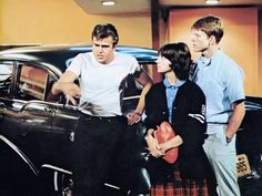 Pictured here are actors Paul Le Mat, Cindy Williams and Ron Howard in a scene from George Lucas' 1973 classic film, American Graffiti. The film received widespread critical acclaim and was nominated for the Academy Award for Best Picture. American Graffiti, Best Teen Movies, Great Movies, I Movie, Movie Stars, Cindy Williams, Epic Film, Ron Howard, George Lucas