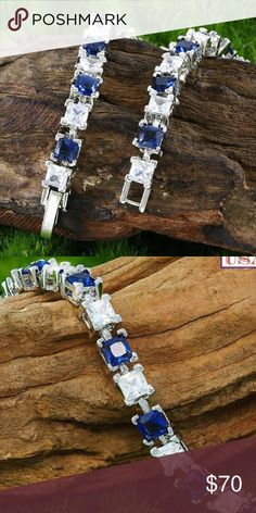 6.50ctw Blue And White Sapphire Tennis Bracelet ~Glamer~  6.50ctw 14k White Gold Filled, Beautifully Created Fine Blue And White Sapphire Tennis Bracelet SM87   Retail :$389.00 >> Got on sale for $148.00  >>  Seriously Priced to sell!   Material: White Gold Filled Condition: New Available Colors: Blue  - 6.50ctw 14k White Gold Filled Beautifully Created Fine Blue And White Sapphire Bracelet   - 7 Inches Long  - 13.5 Grams  - 6.50ctw = Carat Total Weight of Gemstones in the item. Comes in…