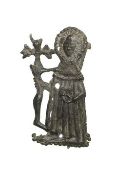 Pilgrim badge from the shrine of John Schorn, probably from Windsor (his remains were moved there in 1478). John Schorn was the miracle-working rector of North Marston in Buckinghamshire from around 1282 until his death in 1315. His tomb became a popular pilgrimage destination, particularly in the 15th and early 16th centuries.  Production Date: Late Medieval; late 15th century