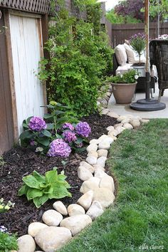 DIY River Rock Planter Border~ see all of the details at ellaclaireinspired.com