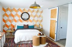 wood and orange and white paint accent wall for the bedroom