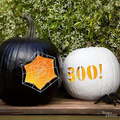 "Anchored by tiny nails, a white web highlights the carved opening in a black pumpkin. For fun, pair it with a contrasting white orb shouting ""BOO!"""