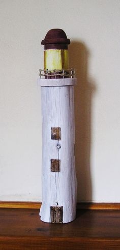 driftwood lighthouse by irini v Driftwood Projects, Driftwood Art, Sea Crafts, Diy And Crafts, Deco Marine, Miniature Houses, Pebble Art, House In The Woods, Coastal Decor