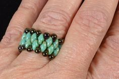 Turquoise green super duo  two hole beaded ring with brown drop beads