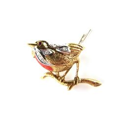 18 ct yellow gold robin red breast brooch. 18 ct yellow gold robin red breast brooch. Set with single cut diamonds and a ruby eye. Length 29 mm. Weight 6.4 grams.