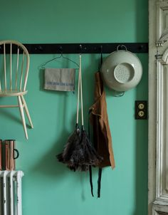 The combination of neutral homeware against a bold mint green backdrop brings an exciting twist to this storage area. The hint of copper stands out perfectly against the green, adding a touch of luxe. Image: Livingetc