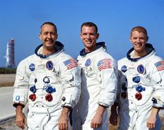 The flight crew of Apollo 9, James A. McDivitt, David R. Scott and Russell L. Schweickart. AS-504 is in the background. (NASA)