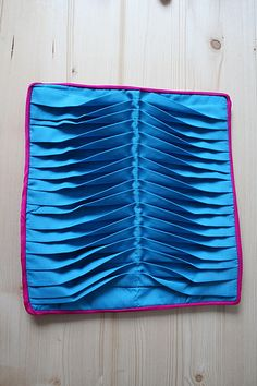 pleating, Fabric manipulation: Ruth Singer pleat fabric and stitch at either side then stitch in opposite direction down centre