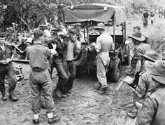 Wounded Australian soldier being helped to a Jeep Ambulance, Aitape area of New Guinea, late 1944