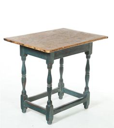 "Queen Anne Tavern Table  American, 18th century, pine and maple. Scrubbed, one-board top on a base with turned legs, box stretcher, and blue paint. Imperfections. 26""h. 28""w. 21""d."