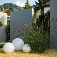 If spheres were grey or dark blue, don't like the white....could store bins behind large panel?