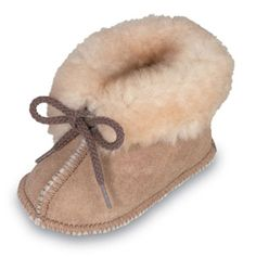 "Minnetonka Infant's Golden Tan  Genuine Sheepskin Bootie.   Product # 1462      ""Moccasin soul"" for little feet. Genuine Minnetonka style, soft rich suede natural leathers - easy to wear and tailored for toddlers.    Color: Golden Tan Sheepskin    Sizes: 1, 2, 3, 4, 5, 6"