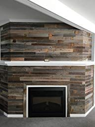 Loving this fireplace! Reclaimed REAL wood walls with Peel and Stick application. So easy to use and makes such a big impact! My DIY wood accent wall makes my space feel like home Stick On Wood Wall, Peel And Stick Wood, Reclaimed Barn Wood, Rustic Wood, Modern Rustic, Modern Farmhouse, Wood Panel Walls, Cozy Fireplace, Raw Wood