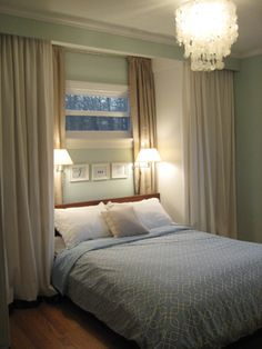 "SO CLEVER! DIY couple made their 12 by 13 foot bedroom with NO closets pretty remarkable. Solutions: creating a nook by ""building-in"" IKEA wardrobes for his/her ""curtain-covered"" closets onto both sides of the bed. Note additional curtains and installing symmetrical ""reading lamps"" -- this way even the oddly shaped small window looks deliberate. Attaching a curtain rod behind a header they installed seems the REAL genius. Well-written. Fun blog!! Inspiring stuff!"