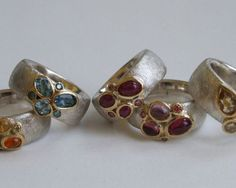 Selection of rings in sterling silver, 18 carat yellow gold, aquamarine, ruby, tourmaline, pink blue and yellow diamonds.