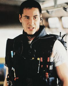 keanu reeves - speed.. those arms in that swat vest!.. he was sure a looker in this movie!
