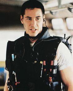 keanu reeves - speed.. those arms in that swat vest!