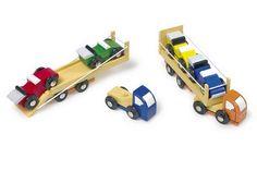 Renntransporter. 2 LKW´s mit je 2 Rennwagen, welche über eine klappbare Rampe verladen werden können. Eine weitere kreative Ergänzung für unser Sortiment an Eisenbahnen & Straßensystemen. ca. 16,3 cm x 3,5 cm x 4,5 cm